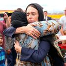 Solidarity: New Zealand Prime Minister Jacinda Ardern hugs a woman during a visit to the Kilbirnie Mosque in Wellington. Photo by Hagen Hopkins/Getty Images