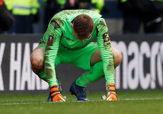 Millwall's David Martin looks dejected after the match Photo: Reuters/Paul Childs