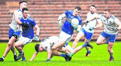 Cavan's Gearoid McKiernan in action against Colin Walshe of Monaghan. Photo: Oliver McVeigh/Sportsfile