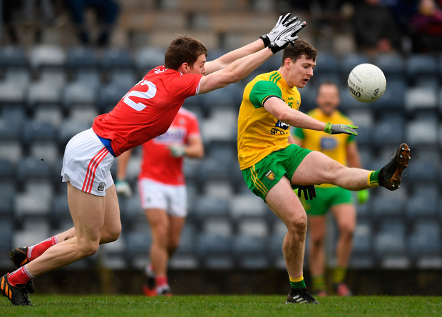 Jamie Brennan of Donegal in action against Ronan O'Toole of Cork. Photo: Eóin Noonan/Sportsfile