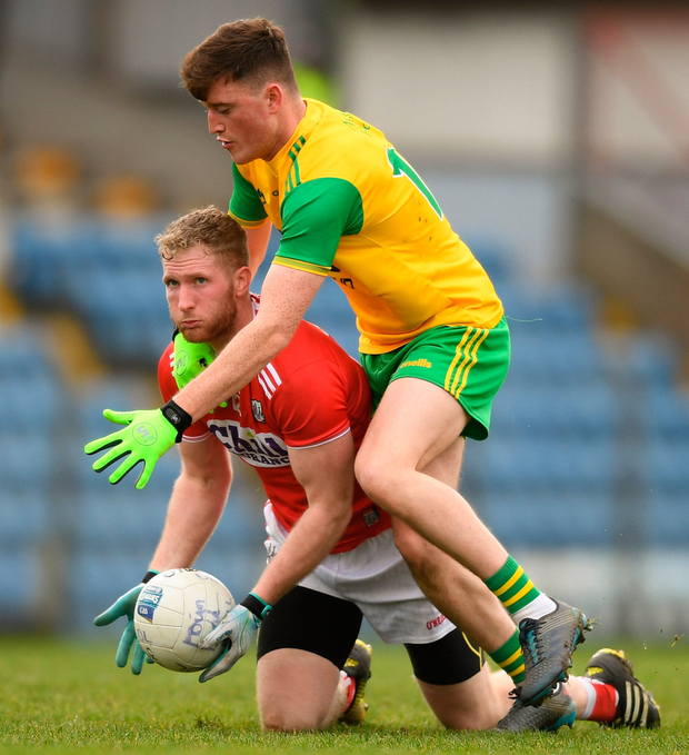 Ruairi Deane of Cork in action against Niall O'Donnell of Donegal. Photo: Eóin Noonan/Sportsfile