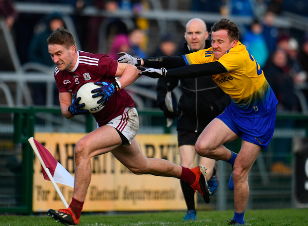 Gary O'Donnell of Galway in action against Aonghus Lyons of Roscommon. Photo: Sam Barnes/Sportsfile