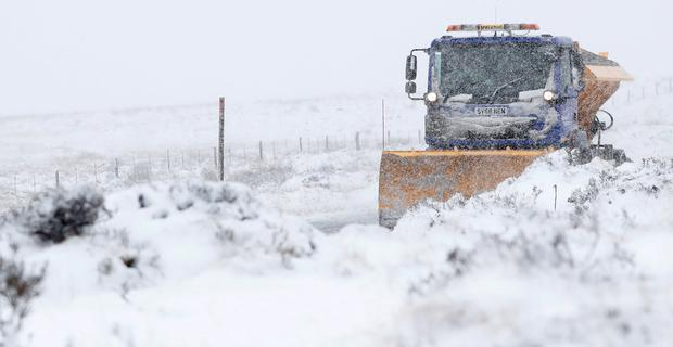 A snow plough clears the A924 near Moulin, Scotland, Britain March 16, 2019.REUTERS/Russell Cheyne