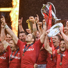 Wales captain Alun Wyn Jones lifts the Six Nations trophy and Jonathan Davies lifts the Triple Crown trophy following the Guinness Six Nations Rugby Championship match between Wales and Ireland at the Principality Stadium in Cardiff, Wales. Photo by Ramsey Cardy/Sportsfile