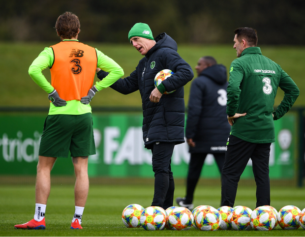 Republic of Ireland manager Mick McCarthy, centre, with assistant coach Robbie Keane, in conversation with Jeff Hendrick, left, during a Republic of Ireland training session at the FAI National Training Centre in Abbotstown, Dublin. Photo by Stephen McCarthy/Sportsfile