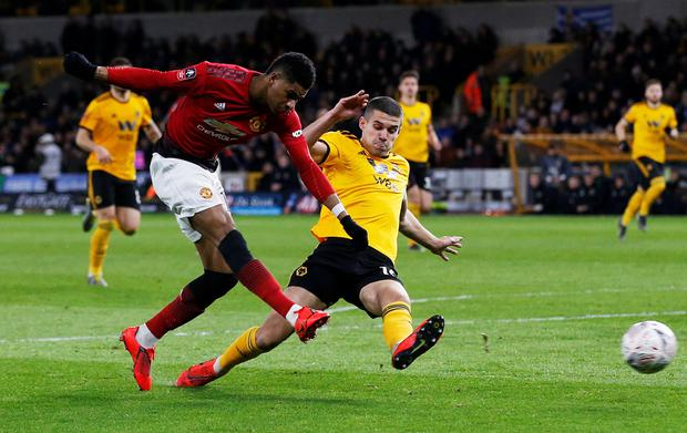 Manchester United's Marcus Rashford in action against Conor Coady in the FA Cup over the weekend. Photo: REUTERS/Andrew Yates