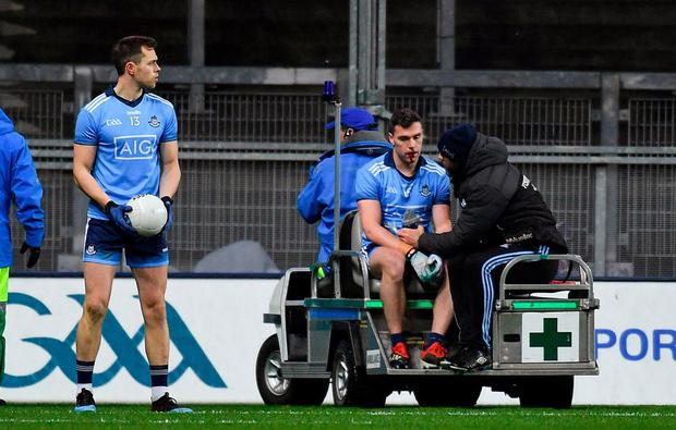Dublin's Paddy Andrews leaves the field on a medical buggy after sustaining a broken jaw. Photo: Piaras Ó Mídheach/Sportsfile