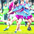 Darragh McBrien scores a point for St Michael's Enniskillen despite the efforts of Omagh CBS's Tom Donaghy during yesterday's MacRory Cup final at the Athletic Grounds in Armagh. Photo: Oliver McVeigh/Sportsfile