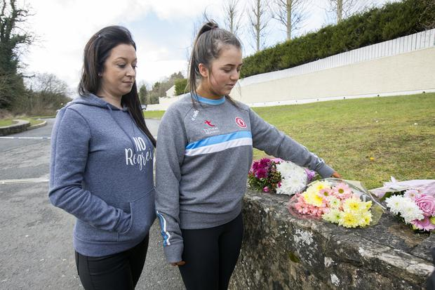 Kyra Coyle, a friend of victim Connor Currie, and her mother Mary bring flowers to the Greenvale Hotel in Cookstown, Co Tyrone. Picture: Tony Gavin
