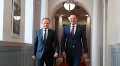 Taoiseach Leo Varadkar (right) walks with European Council President Donald Tusk at Government Buildings in Dublin, for talks ahead of the European Council summit later in the week. Niall Carson/PA Wire