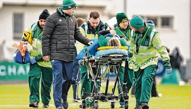 Miller being stretchered off after suffering a broken leg in Donnybrook last yeary. Photo: David Fitzgerald/Sportsfile