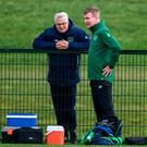 Stephen Kenny in conversation with FAI High Performance Director Ruud Dokter during training in Abbotstown. Photo: Stephen McCarthy/Sportsfile