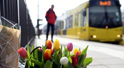 Flowers are placed at the site of the shooting in Utrecht. Photo: Piroschka van de Wouw/Reuters