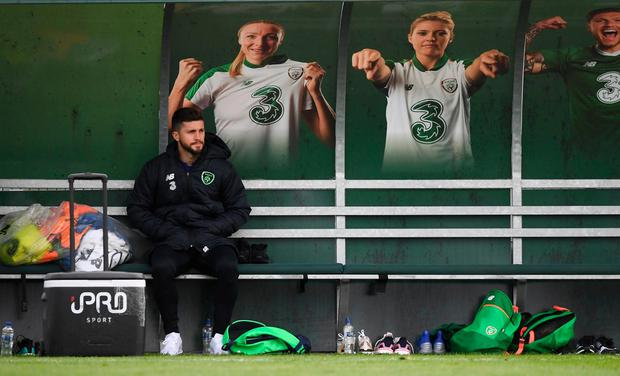 Shane Long watches on from the bench during training at Abbotstown, after being ruled out with a groin problem. Photo: Stephen McCarthy/Sportsfile
