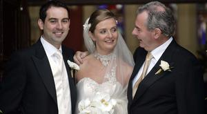 Marriage: Ciara Quinn, daughter of Seán Quinn (right) after her wedding to solicitor Niall McPartland (left). Photo: Collins