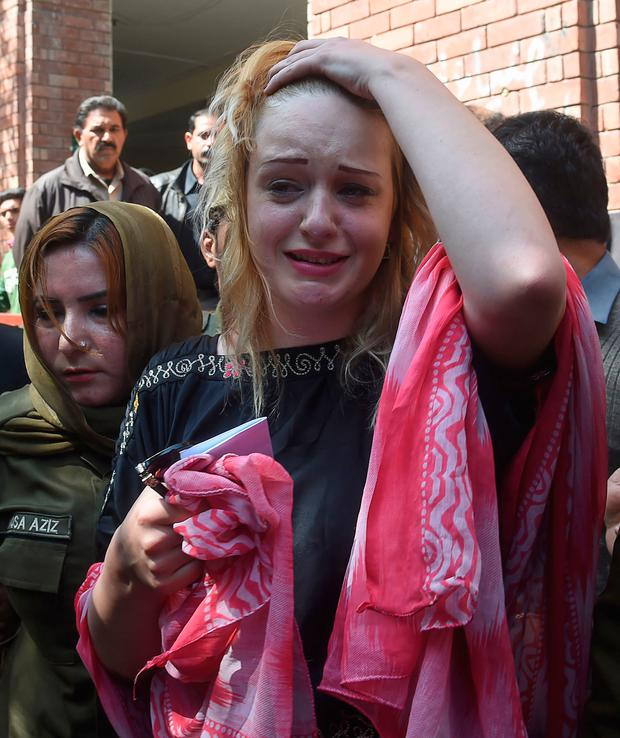 Czech model Tereza Hluskova weeps after the court decision to sentence her to eight years and eight months in prison for attempted heroin smuggling from Lahore to Dublin