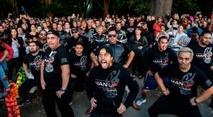 Members of different biker gangs perform the haka as a tribute to victims in Christchurch, five days after the twin mosque shootings. Photo: ANTHONY WALLACE/AFP/Getty Images