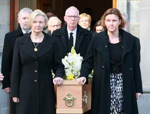 Mourning: Richie Ryan's daughters Aoife and Bláthnaid and son Declan accompany the coffin. Photo: Frank McGrath