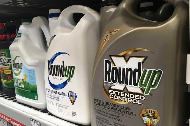 Containers of Roundup are displayed on a store shelf in San Francisco. AP Photo