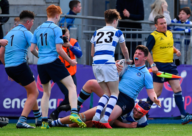 St Michael's College's David Fegan celebrates scoring the winning try late in the game. Photo: Sportsfile