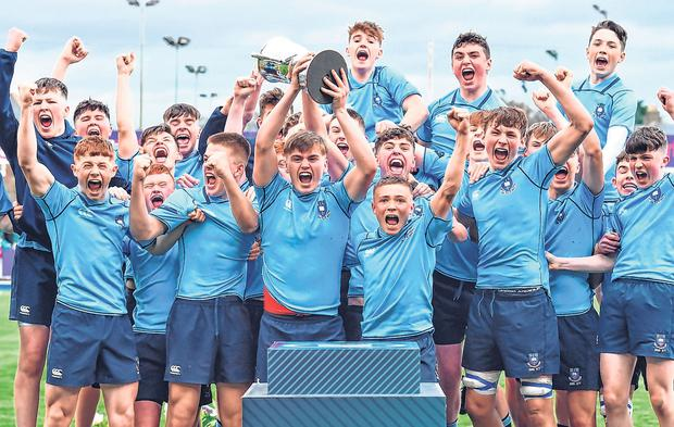 A jubilant St Michael's junior team after their final victory over Blackrock. Photo: Sportsfile