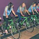 Members of the Roscommon ladies team on stationary bikes