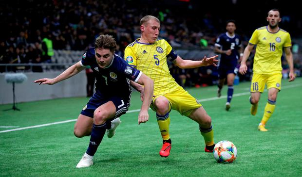 Scotland's James Forrest (left) and Kazakhstan's Islambek Kuat. Photo: Adam Davy/PA Wire