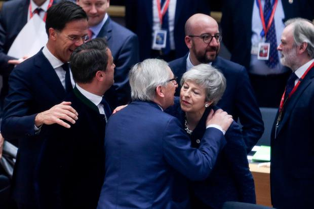 European Commission President Jean-Claude Juncker embraces Britain's Prime Minister Theresa May as they attend a European Union leaders summit in Brussels, Belgium March 21, 2019. Aris Oikonomou/Pool via REUTERS