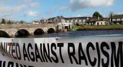 Tolerance: A banner on display during an anti-racism rally titled 'Love Rooskey: No to Racism: Asylum Seekers Welcome', in Rooskey in February. Photo: PA
