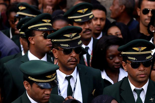 Ethiopian Airlines crew members mourn as pallbearers carry coffins of their colleagues at the Holy Trinity Cathedral Orthodox church in Addis Ababa. Photo: Tiksa Negeri/Reuters