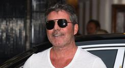 Simon Cowell breaks long social media silence with picture of son Eric (Kirsty O'Connor/PA)