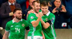 Northern Ireland's Niall McGinn (centre) celebrates scoring his side's first goal of the game during the UEFA Euro 2020 Qualifying, Group C match at Windsor Park, Belfast. Niall Carson/PA Wire