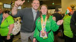 Niall Quin & Special Olympic athlete Lucy Dollard from Kilkenny during a return by Team Ireland at Dublin Airport who competed at the Special Olympics World Games in Abu Dhabi with a haul of 86 medals. Photo: Gareth Chaney Collins