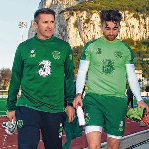 Striking the right balance: Robbie Keane with Seani Maguire at training yesterday. Photo: Stephen McCarthy/Sportsfile