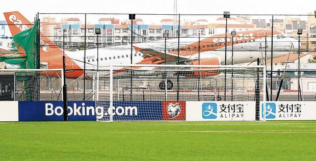 A plane taking off provides an unusual backdrop. Photo: Stephen McCarthy/Sportsfile