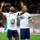 England's Raheem Sterling celebrates scoring his side's third goal