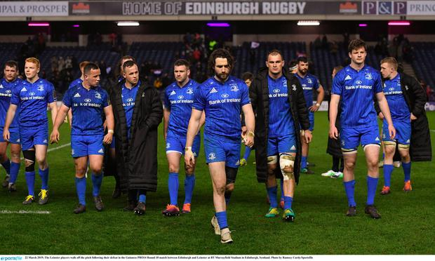 Leinster players walk off the pitch following their defeat