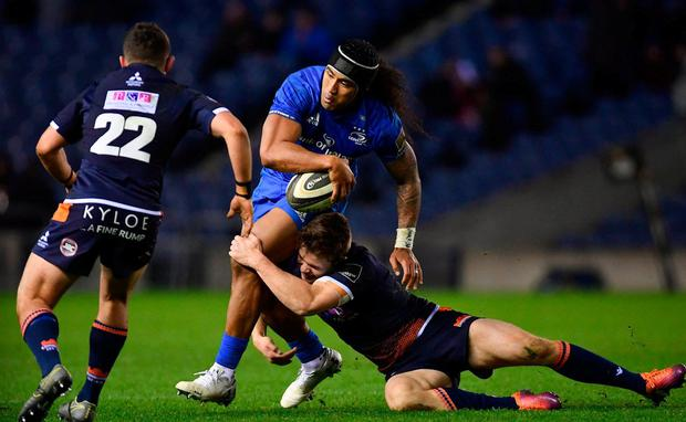 Leinster's Joe Tomane is tackled by Edinburgh's Simon Hickey, left, and Chris Dean. Photo: Ramsey Cardy/Sportsfile