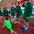 James McClean stretches the leg of Jeff Hendrick during a Republic of Ireland training session at Victoria Stadium in Gibraltar. Photo by Stephen McCarthy/Sportsfile