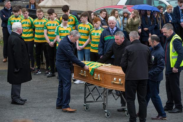 Members of Edendork St Malachy's GAA club give a guard of honour at the funeral of Connor Currie at St Malachy's Church. Photo: Mark Condren