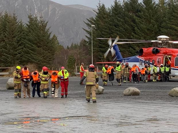 Rescued passengers from a cruise ship Viking Sky, after an engine failure, are assisted by a rescue team in Hustadvika, Norway March 23, 2019