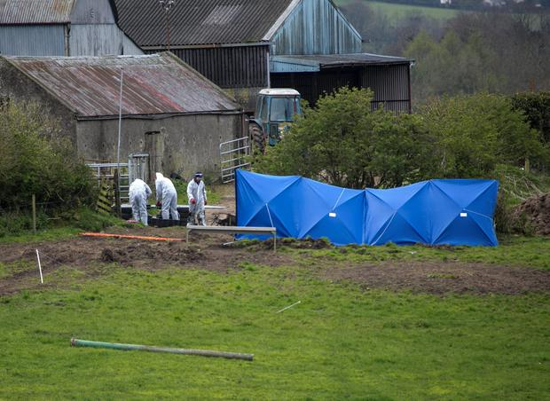 Forensic officers at the scene where the body of Bobby Ryan was discovered in a run-off tank on the farmland leased by the accused Patrick Quirke at Fawnagown, Tipperary on April 30, 2013. Picture Credit: Press 22