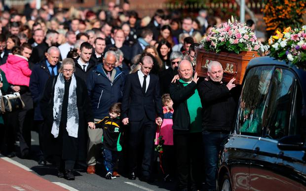 The coffin of Ruth Maguire at St Vincent de Paul Church, Ligoniel, Belfast, as her husband-to be and children follow. Photo: PA