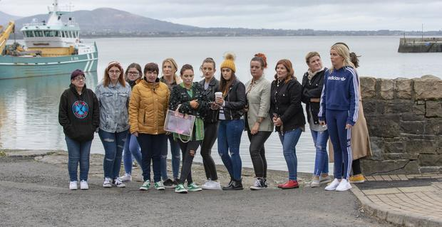 Ruth Maguire's friends gather on the harbour at Carlingford, Co Louth to search for her