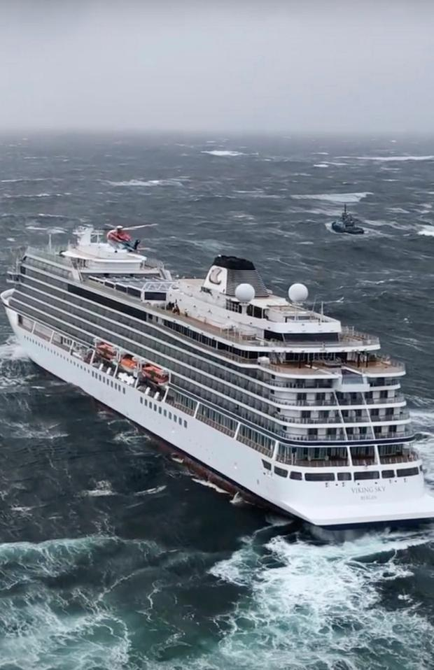 In this image taken from video made available by CHC helicopters, helicopters fly over the cruise ship Viking Sky