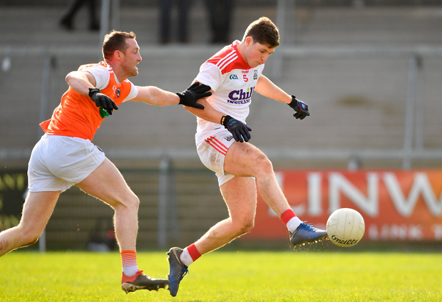 Kevin Crowley of Cork shoots to score his side's third goal of the game despite the attention of Armagh's Ryan Kennedy. Photo: Ramsey Cardy/Sportsfile