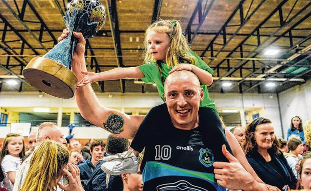 Kieran Donaghy celebrates Tralee Warriors' victory with his daughter Lola Rose (3) after securing Super League victory. Photo: Diarmuid Greene/Sportsfile