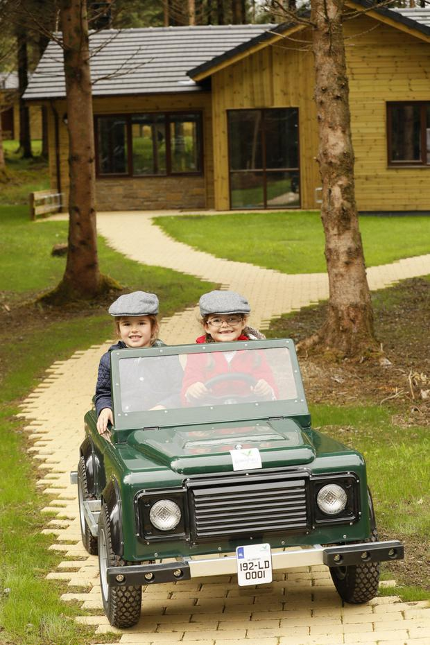 Driving seat: Maisie (6) and Bonnie Conway (5), from Ballymahon, try the off-road explorer experience at Center Parcs Longford Forest ahead of its opening. Photo: Kieran Harnett