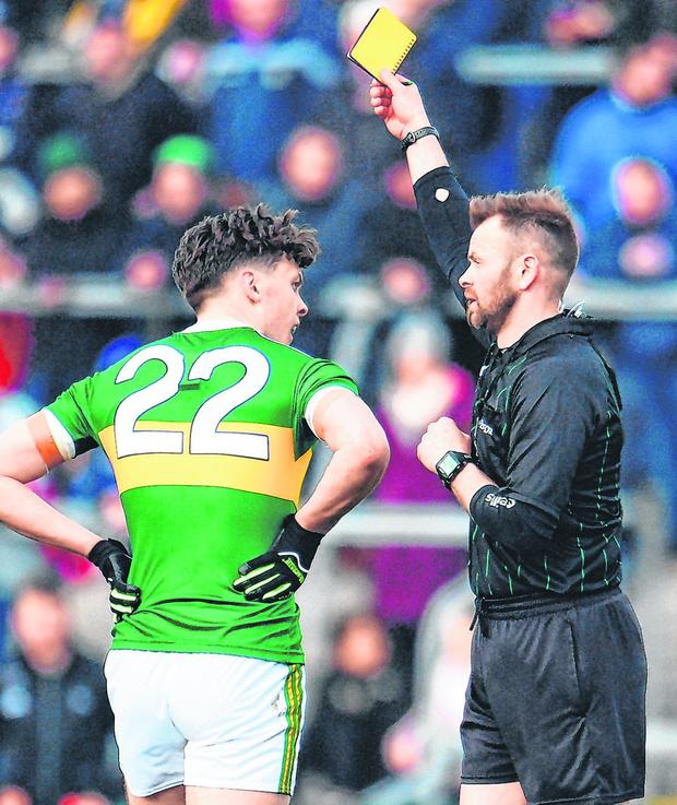 Referee Anthony Nolan shows Kerry star David Clifford a yellow card during yesterday's victory over Roscommon in Dr Hyde Park. Photo: Sam Barnes/Sportsfile