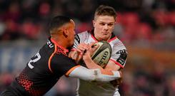 Ulster's Angus Kernohan is tackled by Harlon Klaasen of Isuzu Southern Kings. Photo: Ramsey Cardy/Sportsfile